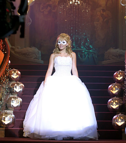 Hilary Duff in A Cinderella Story coming down the stairs at the Halloween Dance