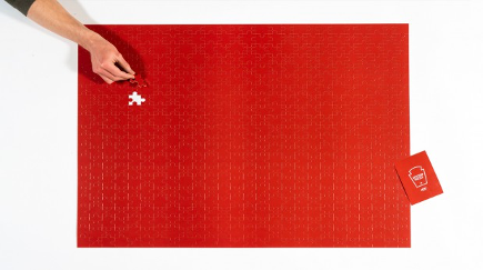 monochromatic red puzzle with one piece missing